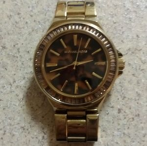 MK watch gold with cheetah print/tortuous face